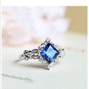 Blue Topaz in white gold Ring size 6